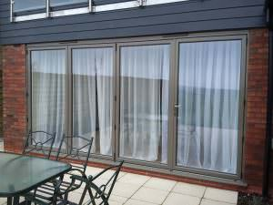 closed grey Aluminium Bi-Fold Doors