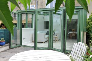 green Aluminium Bi-Fold Doors